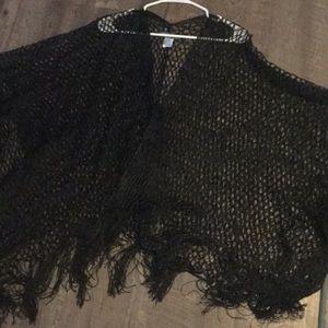 A lace and fringe shrug